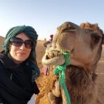 women only travel group with camel