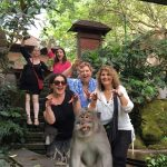 women only travel group with monkey